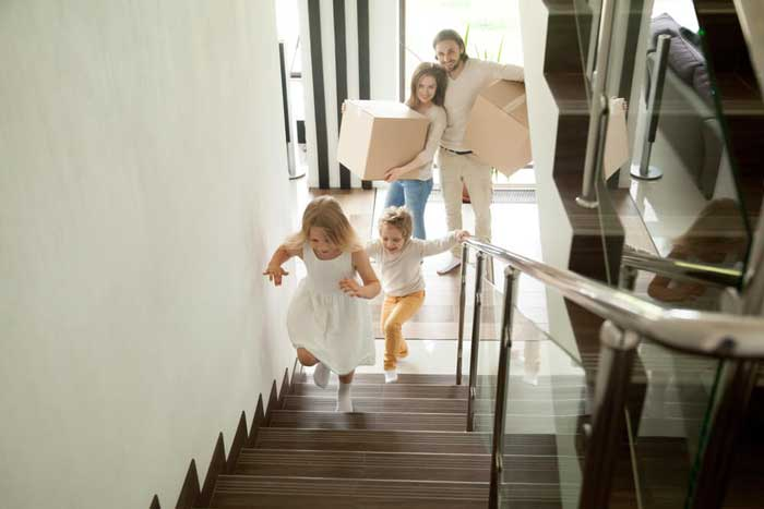 family walking up apartment stairs