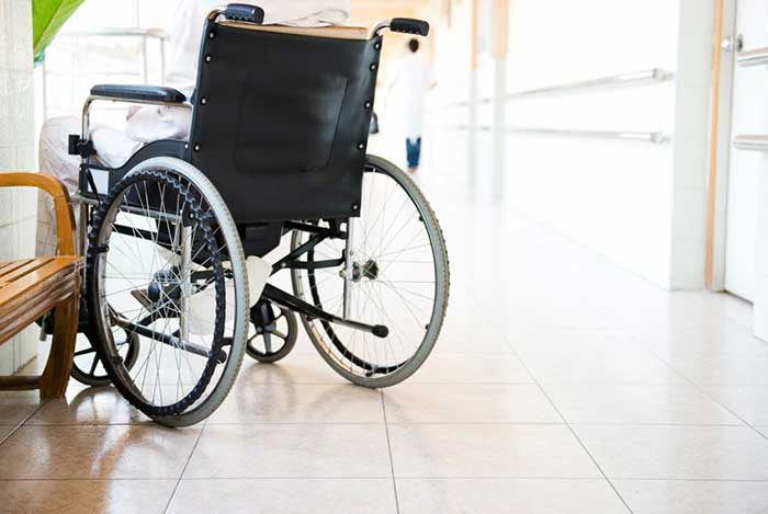 Wheelchair parked in hospital hallway.